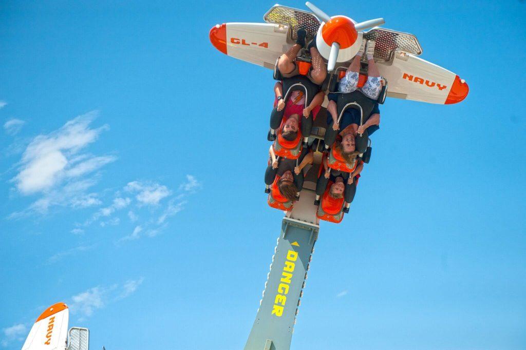Upside down visitors riding Air Racer at The Park at OWA