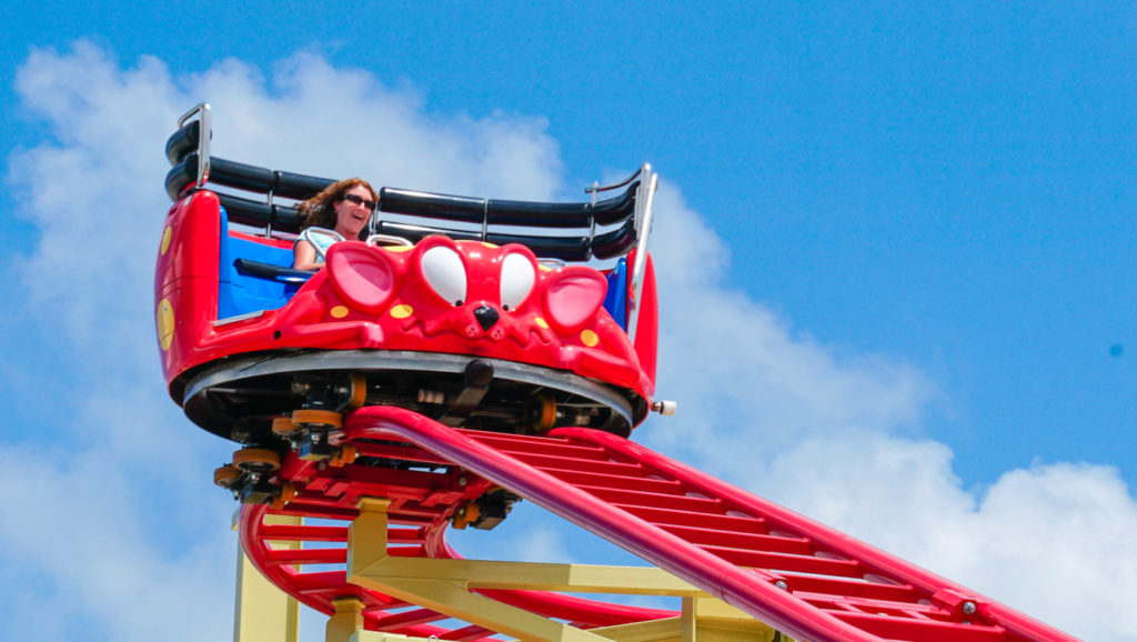 A woman riding the Crazy Mouse rollercoaster