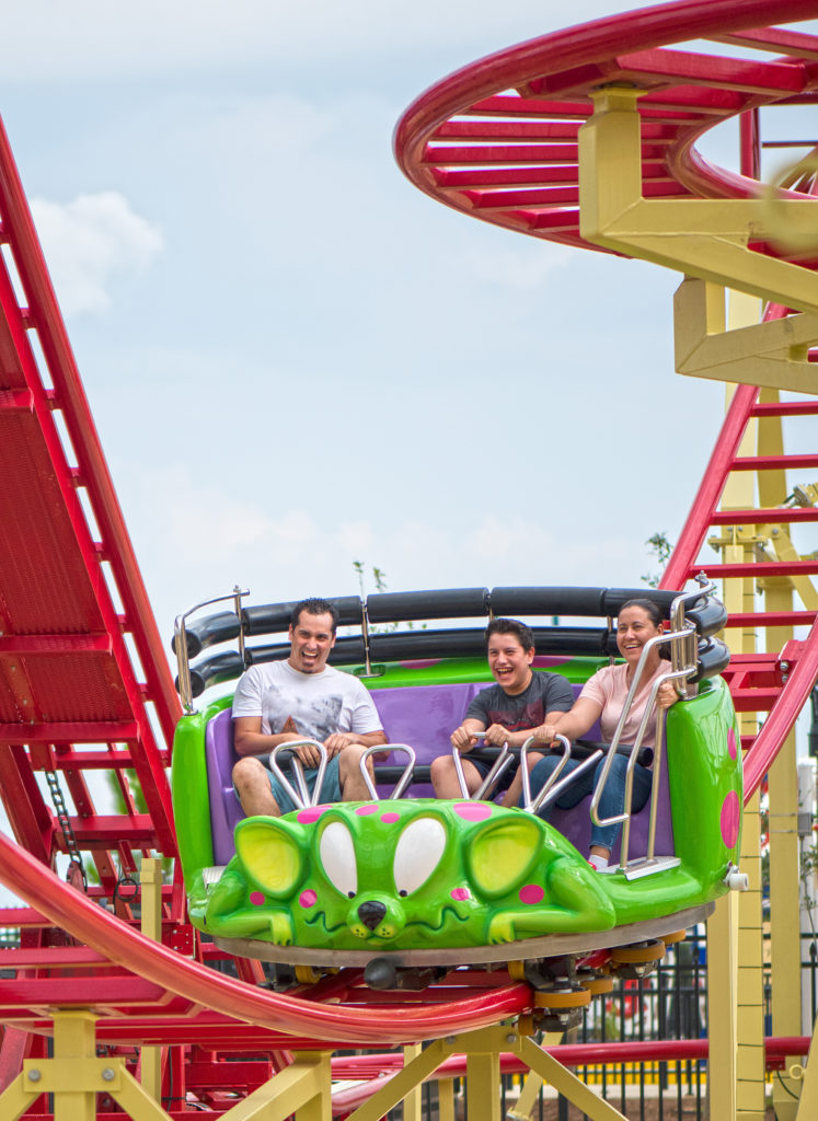Three riders on the Crazy Mouse