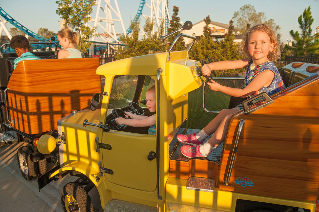 Children steering a truck in the Happy Haulers ride