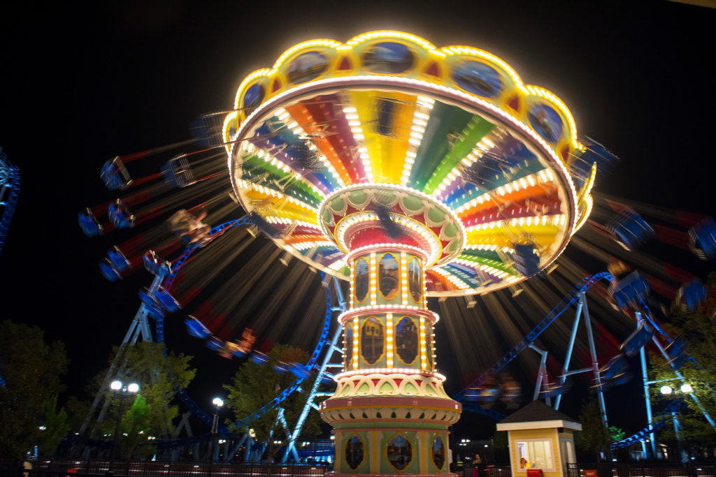 The Flying Carousel lit up at night