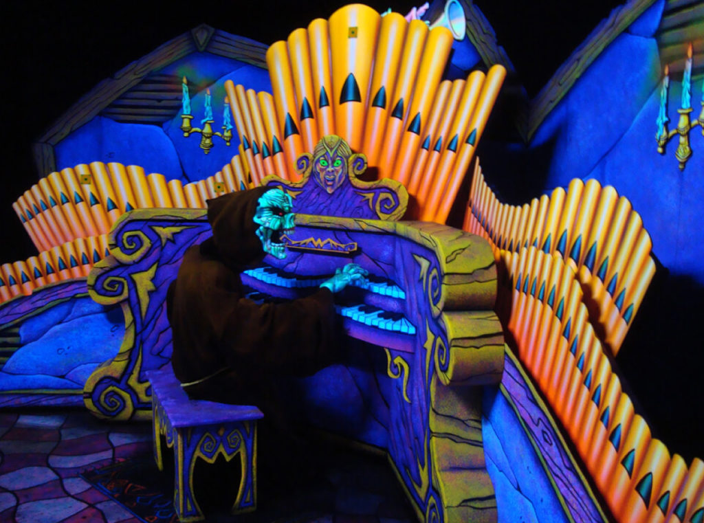 A skeleton playing a large pipe organ