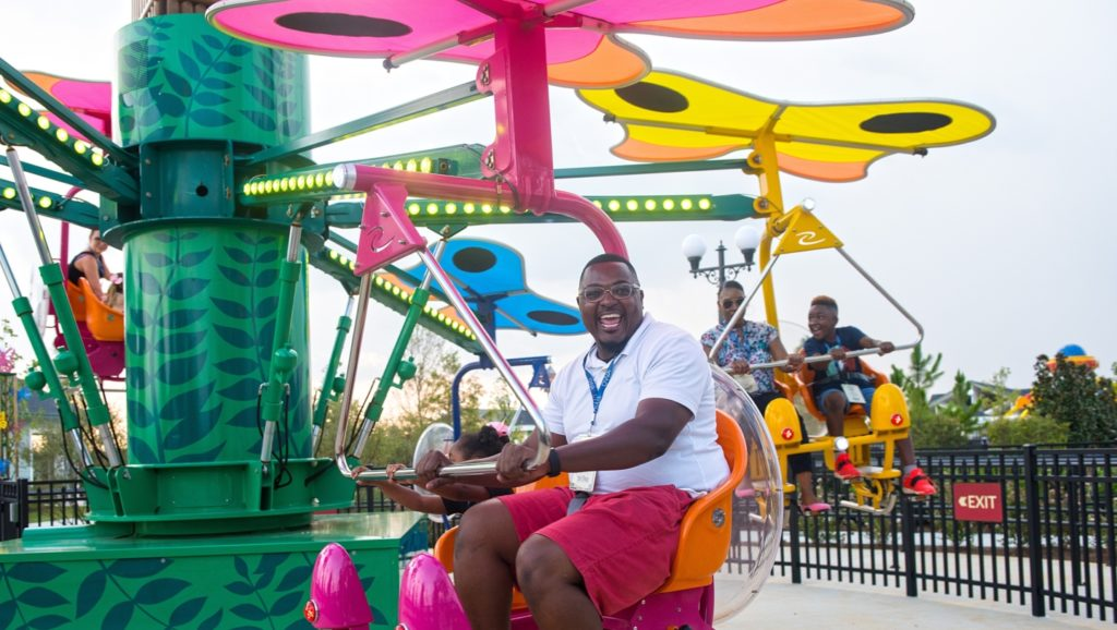 A man laughing while riding the Flutter By