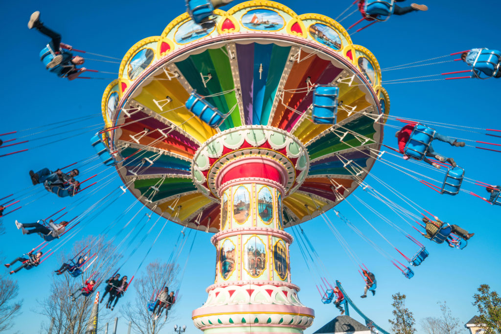 Riders swinging around the Flying Carousel