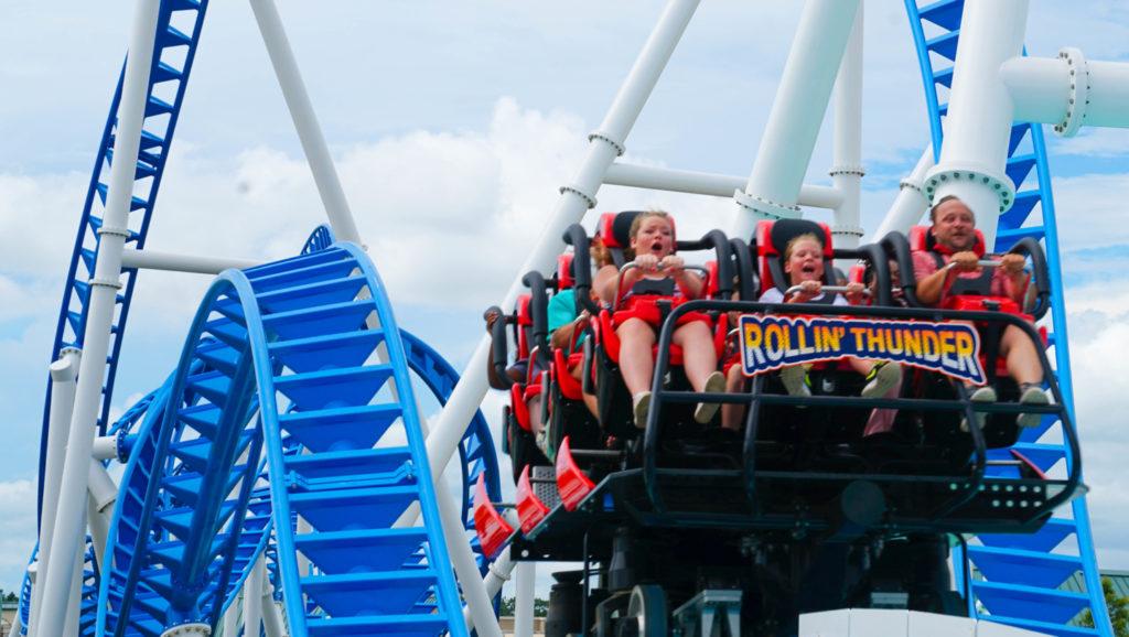 Riders speeding on the Rollin' Thunder rollercoaster
