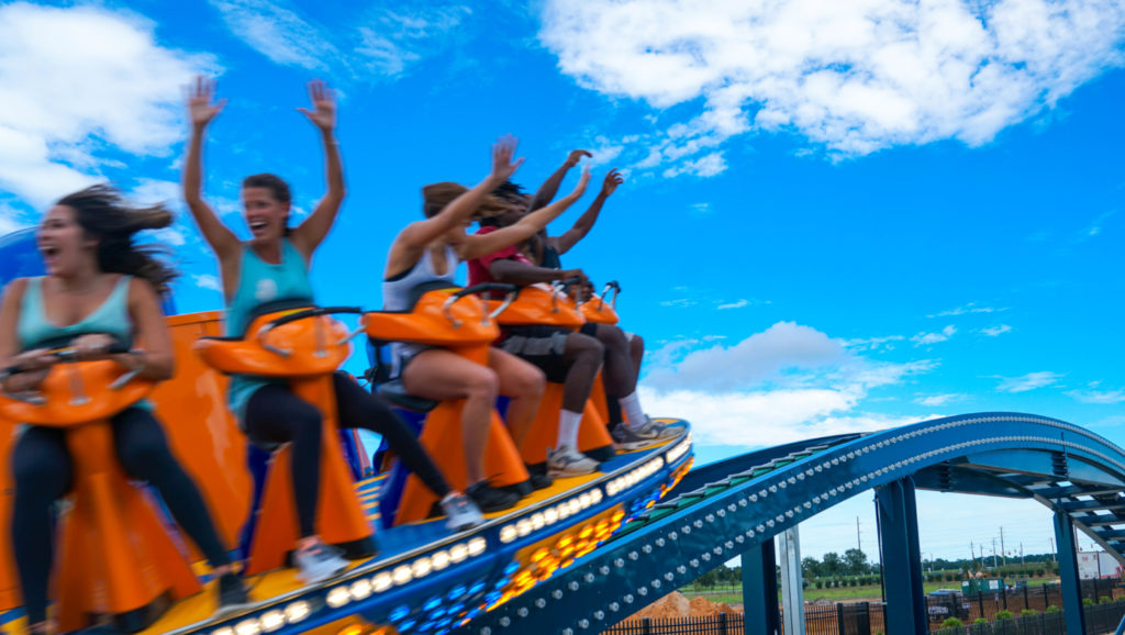 Riders speeding by on the Wave Rider rollercoaster