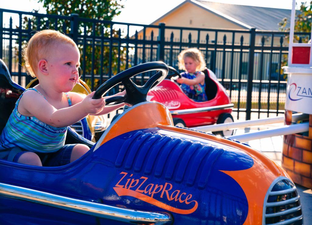 Children driving cars in the Zip Zap Race
