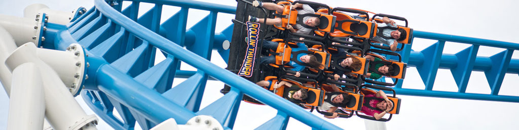 Riders turned sideways on the Rollin' Thunder rollercoaster