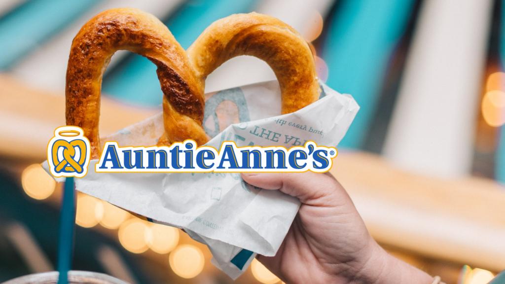 A hand holding a pretzel