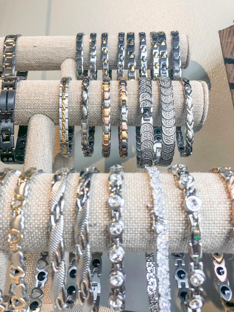 An assortment of bracelets on stands