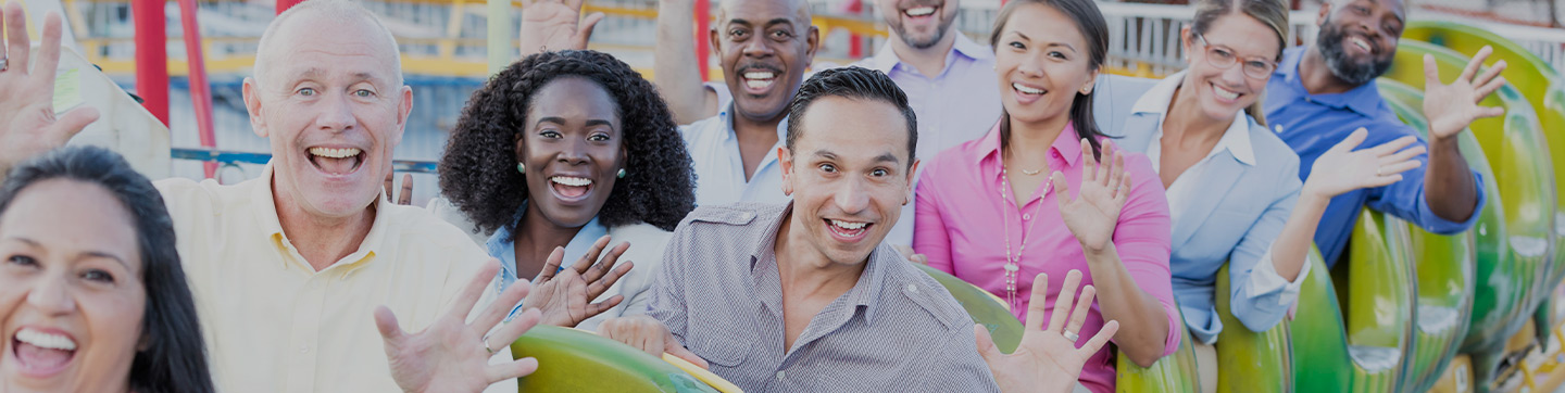 Corporate employees waving from a ride