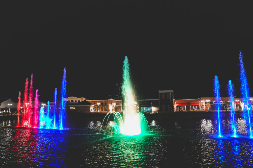 Downtown OWA's fountain lit up at night