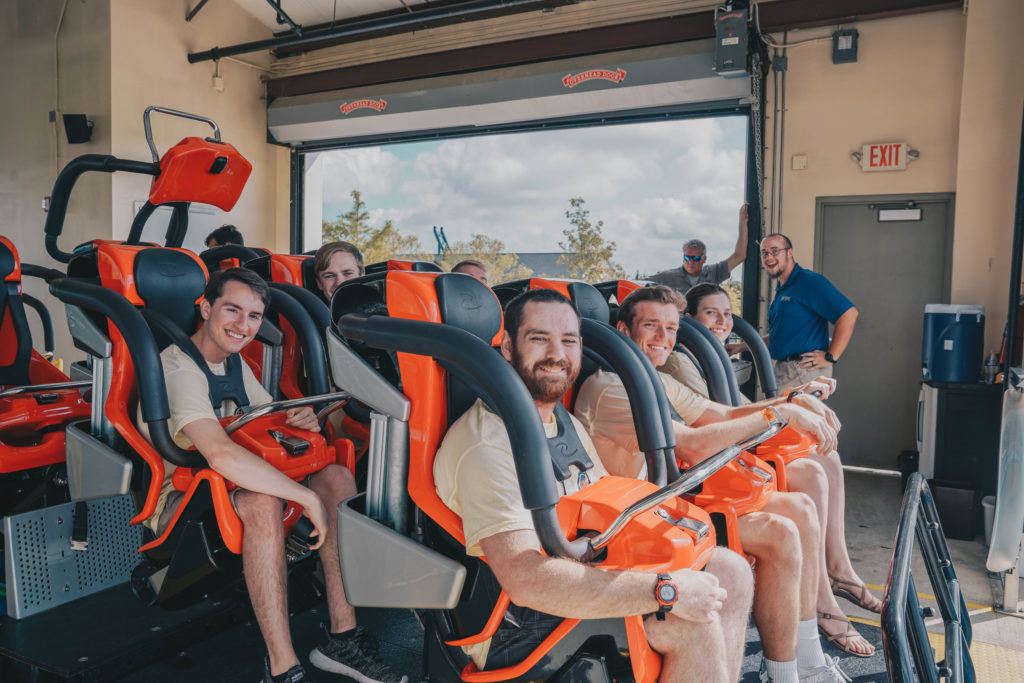 Attendees of an Education in Motion event seated in a rollercoaster