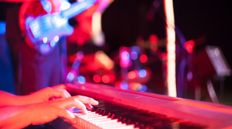 Musician playing on electric keyboard at jazz music festival