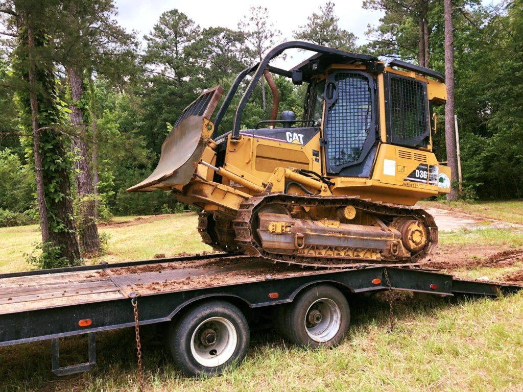A bulldozer on a trailer