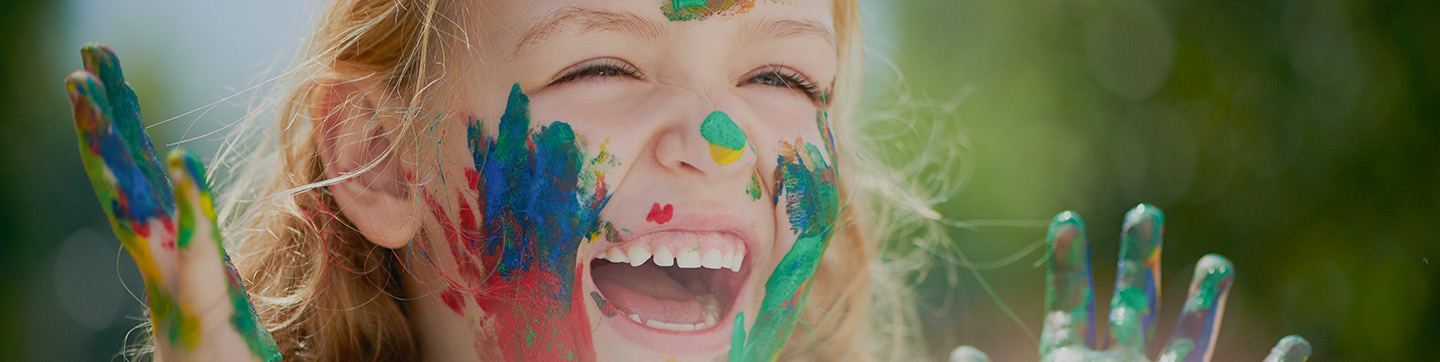 A child in face paint smiling