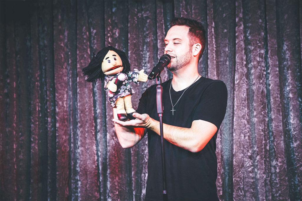 Brandon Styles holding a puppet