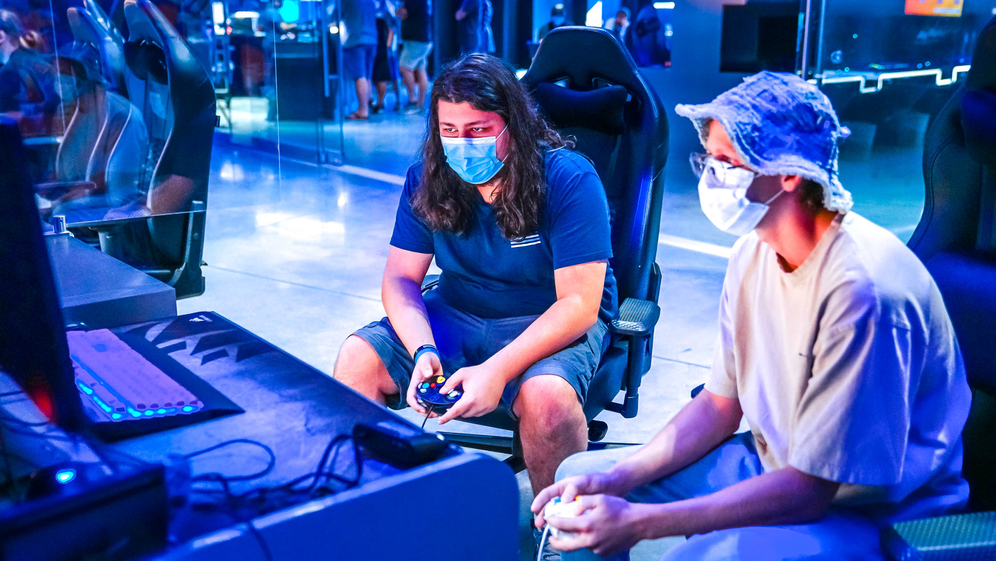 Two people playing a video game in the Clash eSports Center