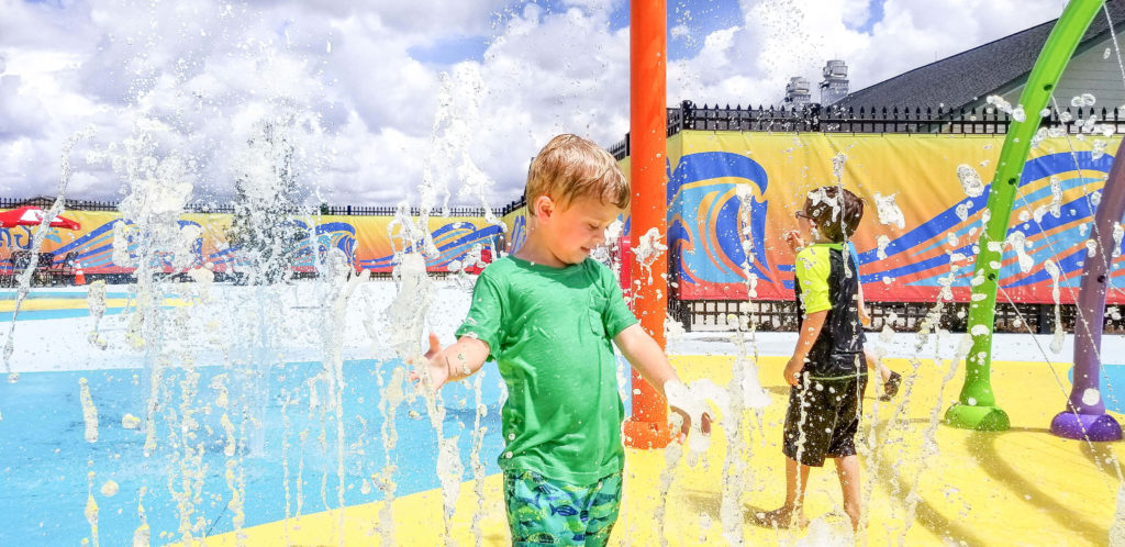Children playing with jets of water in the Wacky Waters splash pad