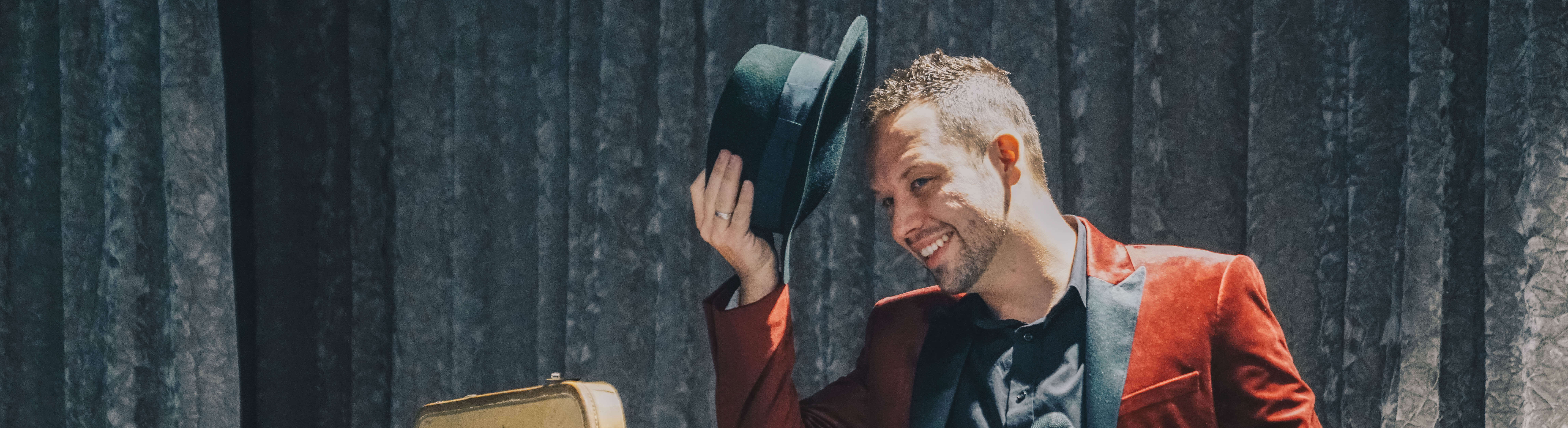 Brandon Styles tipping his hat while performing on stage